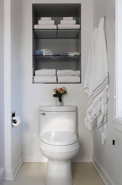 Fantastic bathroom features recessed shelves over the toilet ...