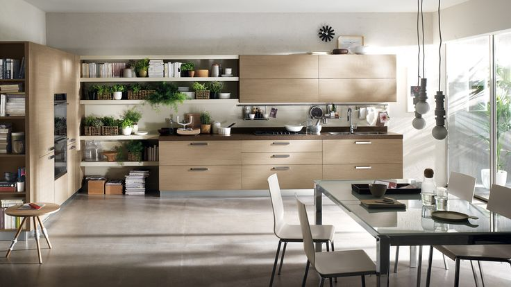 Feel Kitchen - Design by Vuesse. By combining practicality with a stylistic light touch, Feel fits naturally into an open space layout that merges the pleasures of cooking, relaxation and dining.