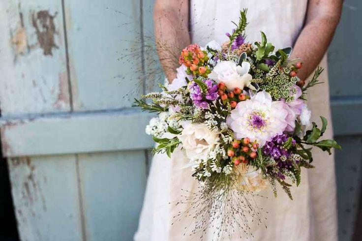 Dahlia 'Eveline', Hypericum, Phytosegia, Panicum grass, Statice Bridal bouquet.