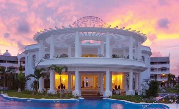 Excellence Riviera Cancun, Mexico. All-inclusive, adults only. Eight restaurants to choose from, 10 bars poolside and swim-up, 6 pools, Miile Spa/fitness center, 2 lighted tennis courts, live entertainment, water spots, etc.