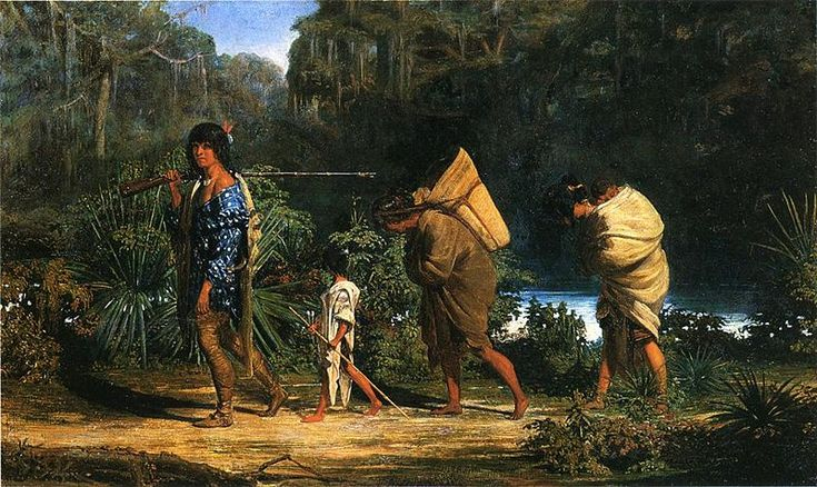 Louisiana Indians Walking Along a Bayou. - A man, two woman, and child are walking along a river in a marshy area. The man, who leads, carries a long rifle over his shoulder. A boy follows, holding a long stick, probably a bow or blowgun. A woman carries a basket over her shoulders, while the second woman carries a sleeping baby on her back. Both women have their heads bowed as the males look on. Painted by Alfred Boisseau, 1847.