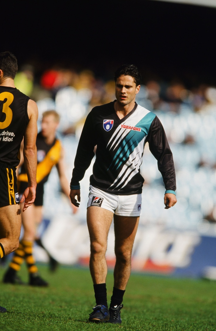 Port Adelaide's first AFL away jumper was a predominantly black variation of its home guernsey, with three lightning flashes across the front of the guernsey.