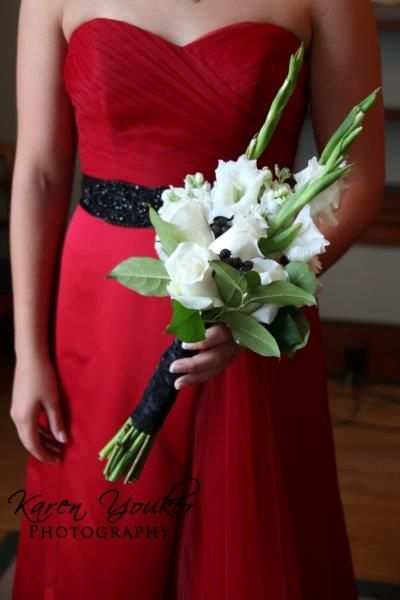 Bridesmaid bouquet: white rose, gladiolus, and black berries.  Photo courtesy of Karen Youker Photography.