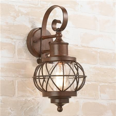 "Westport Outdoor Wall Lantern:Westport Outdoor Wall Lantern With the nautical flair of a waterside town of Westport, this onion shaped, caged lantern is big on value and style. The mottled brown finish and seeded glass blend nicely with bronze, copper and iron for outdoor and interior wet location applications. Zinc plated steel. 60 watt medium base bulb. (15""H x 8""W x 8.75""D) 4"" round backplate center is 10"" from the bottom of the fixture. Product SKU: OL14022 BZ Price: $100.00"