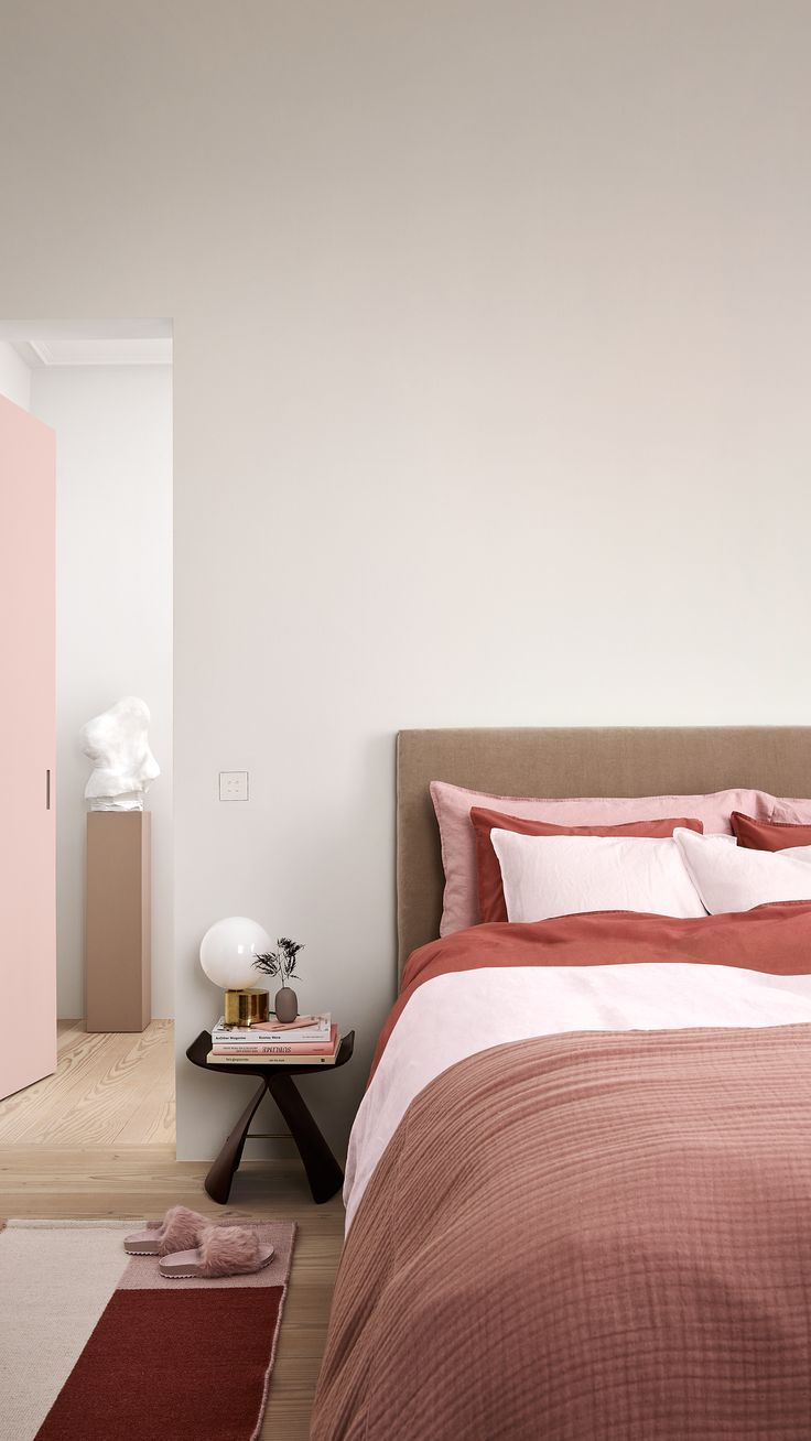 Soft, powdery pink and deep ruby reds work together to create a harmonious and modern home.