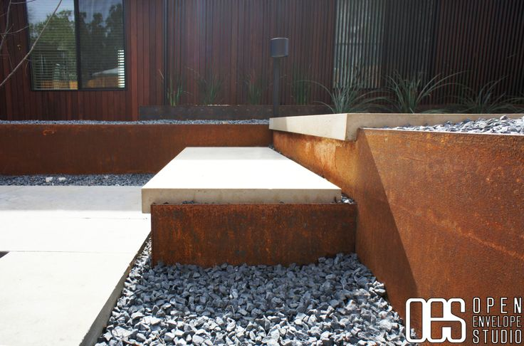 OES Limestone paver detail with steel retaining wall and