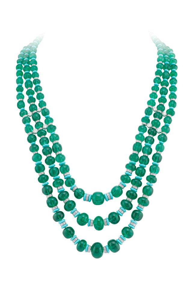 Van Cleef & Arpels - Biches necklace, Fairytale Collection Peau d'Âne (Donkey Skin), Three rows of emerald balls from Afghanistan make up the majestic Biches necklace. Weighing a total of 555.37 carats, the ensemble brings together 188 stones notable for their intense and even color: a deep green with a hint of blue. This magnificent creation is enhanced by a touching scene on the clasp, depicting two does. 2004. 1/2