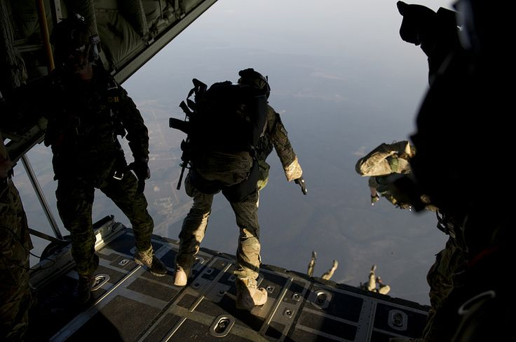 Special operations jumpers from the Canadian Special Operations Regiment, Green Berets of 7th Special Forces Group (Airborne) and Para-rescue Airmen from the Air Force Special Operations Command begin exiting a British C-130 from the Royal Air Force during a high altitude low opening parachute jump (HALO) Hurlburt Field, Fl., April. 25, 2013. Special operations members from coalition forces participated in HALO jumps during Exercise Emerald Warrior, Emerald Warrior is an exercise designed…