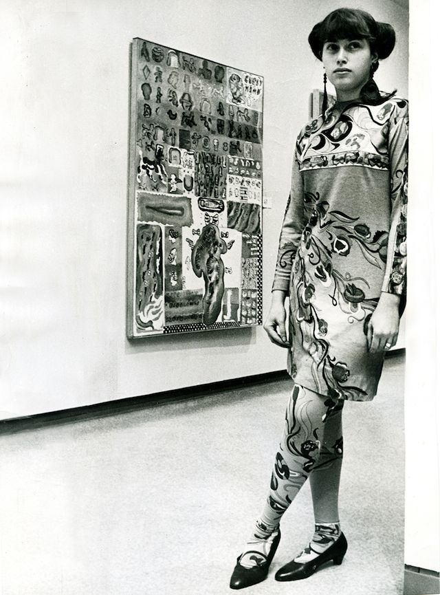 "Hairy Who artist Suellen Rocca with her painting ""Curly Head"" (1967), unidentified materials and unspecified dimensions (photo by Bob Kotalik, Chicago Sun-Times, courtesy Pentimenti Productions)"