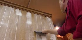how to paint sheet paneling (the kind that's not real wood)- filling in the grooves so it doesn't look like paneling