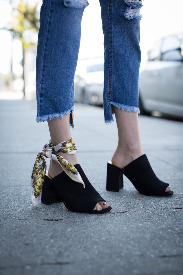 Find unique ways to style your outfit. Use a silk scarf as an ankle accessory and pair it with a pair of classic black heeled mules.   #mules #howtostyle #silkscarf