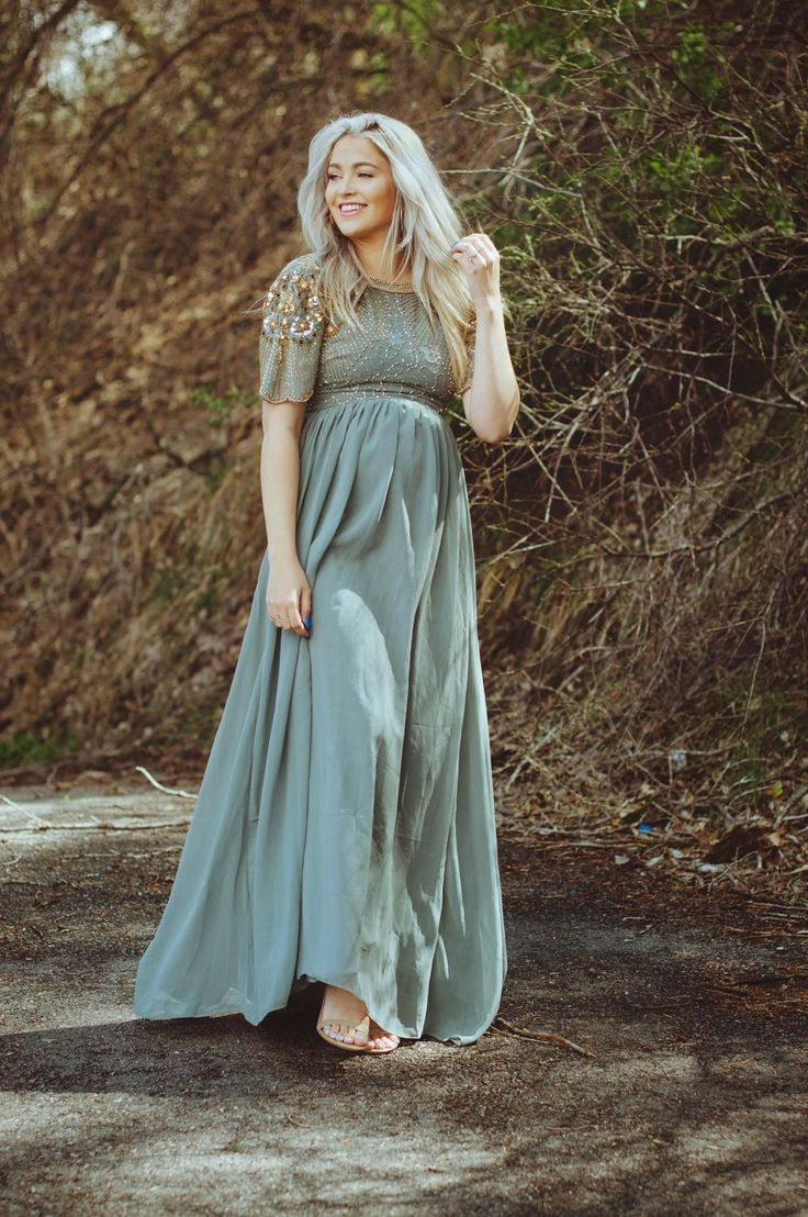 A dress is no-brainer when it comes to classic holiday attire. Cara of Cara Loren looks beautiful in her dusty blue dress. The embellishments on the shoulders and bust add fancy detail to the column silhouette. Throw your hair up in a chignon, and add a fur coat to keep you warm. Bonus: A maxi dress that hits the ground hides your shoes, so go ahead, wear those comfy flats.