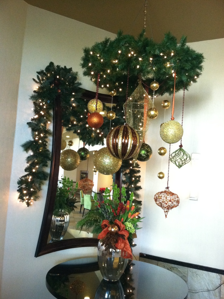 Turn a wreath on its side & hang lengths of ribbon attached to Christmas balls. It looks beautiful!