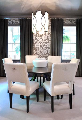 Yes, I can totally see a dark, round table like this in my dining room!