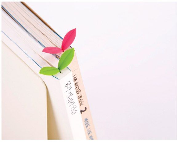 Cute little sprout! The little bookmark can be placed either inside the book, where the leaves actually open up when you open the book, or it can be placed on the edge of the book. Buy it here.