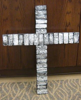 Cross made out of tiles embossed with shoeprints.