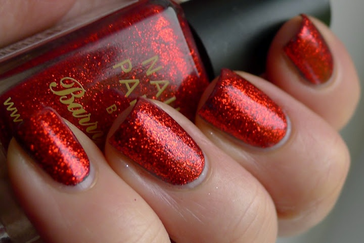 This red glitter nail polish by Barry M is perfect for the Christmas season. #beauty #nails #barrym