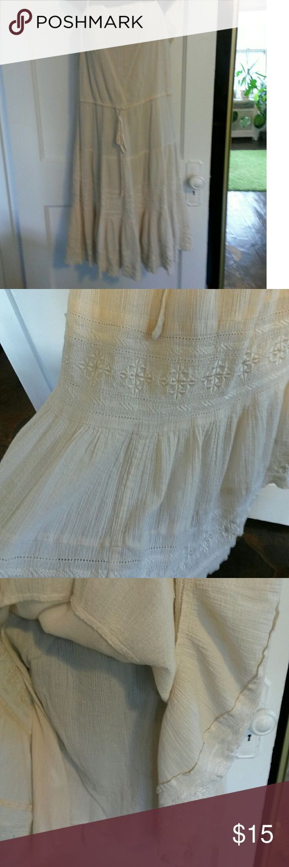 """Light cream summer dress 100% cotton.  String tie around waist. Pretty pattern near bottom,  on bottom and around top. 4 button closure on side. Adjustable straps. Built in slip.  Light elastic at top of back. 35"""" from top of chest to bottom.  Not including straps. Says dry clean only but we've always just washed it on gentle cycle. BCBGMaxAzria Dresses Midi"""