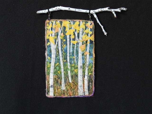 Aspens.  Small art quilt hanging from a tree branch