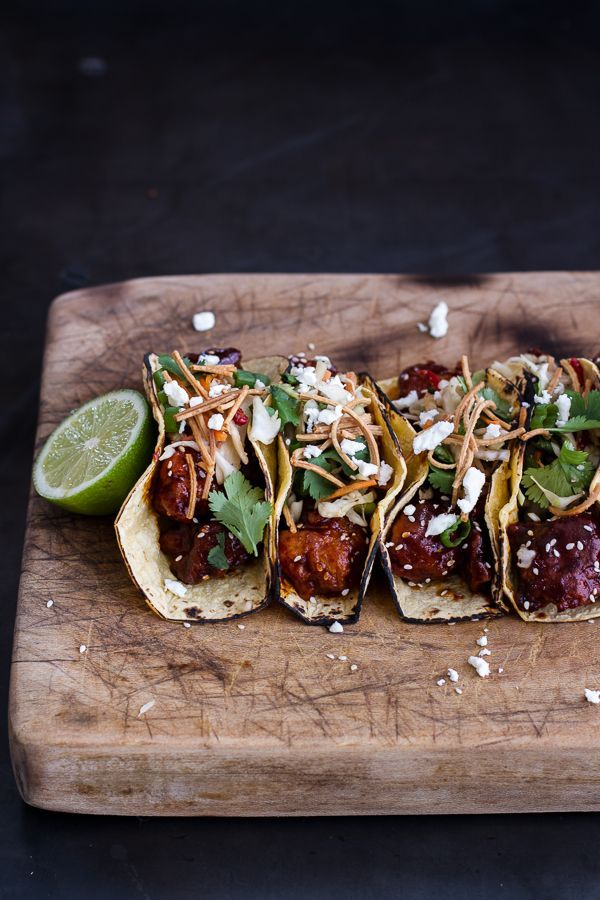 These fried chicken tacos are topped with crispy noodles and queso fresco.  Get the recipe from Half Baked Harvest.   - http://Delish.com