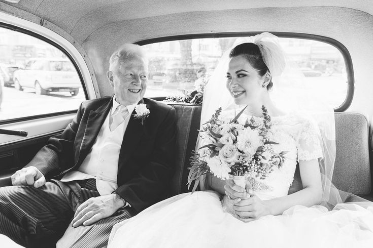 Bride and her father ride in a white London taxi to Burgh House in Hampstead.