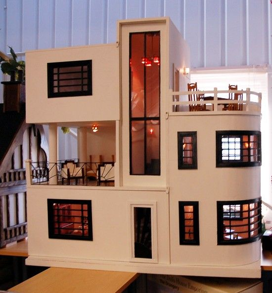 Art deco dollhouse from dolly daydreams. Love the 2nd floor balcony, possibly off the master.