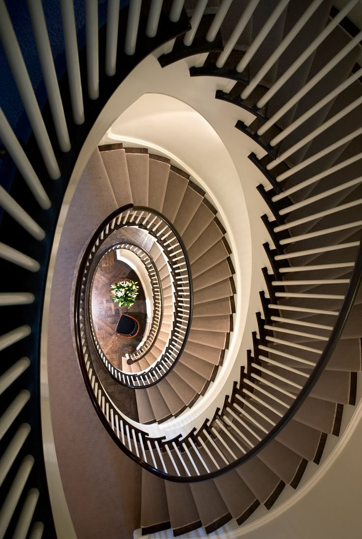 Stair spiral in a New York City townhouse home. http://cococozy.com