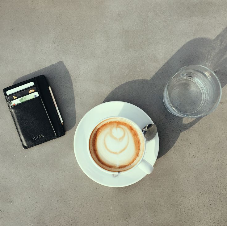 Enjoy your cappuccino next to your NEAL Front Pocket Wallet, made from flawless Italian leather.  #slimwallet #minimalistwallet #frontpocketwallet #thinwallet #rfid #rfidprotection #wallet #blackwallet #giftsformen #mengifts #giftbox #giftset #travelwallet
