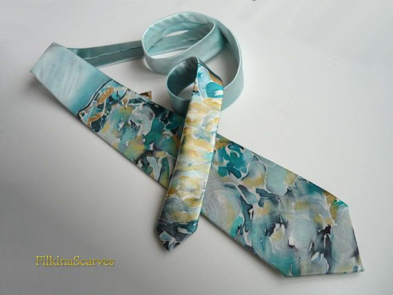 Men's SILK Tie-Mens Necktie-Silk Tie-Blue by FilkinaScarvesUnique hand-painted tie with floral elements - abstract roses - in blue, ocher, gray on a light blue background. With use of beewax technique, professionally hand-sewn after being painted. Fabric is 100% natural silk satin