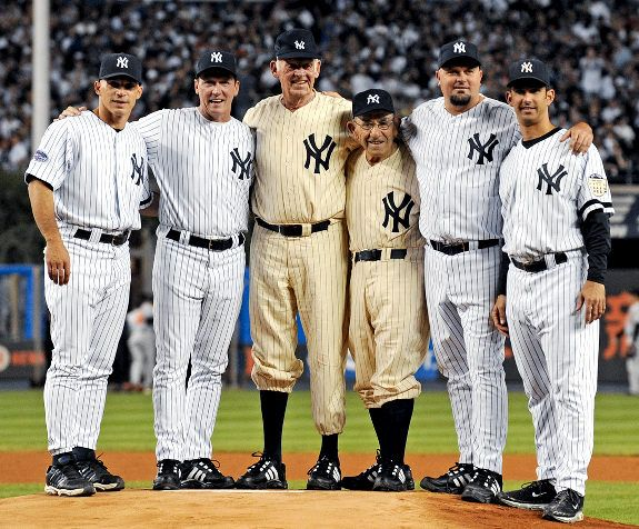 Now that's a photo for the Yankee Stadium scrapbook: Joe Girardi (from l.), David Cone, Don Larson, Yogi Berra, David Wells and Jorge Posada pose on the mound.