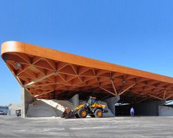 24H unites highway support center beneath gridshell Timber roof