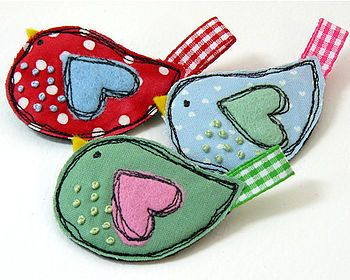 Cute bird by Little Singing Bird....no longer available but so cute. I like the idea of stitching in black like a cartoon outline!