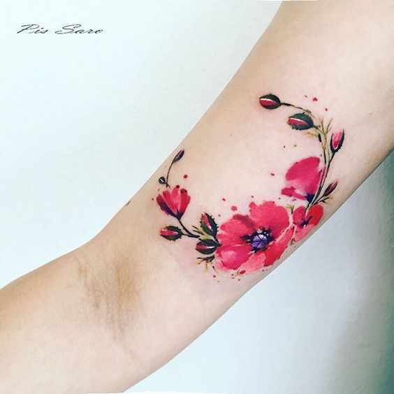 Bright red poppy tattoo by Pis Saro.   Poppy tattoos are extraordinary and we have found some of the most exquisite poppy tattoos ever done. Thanks for caring, thanks for sharing.