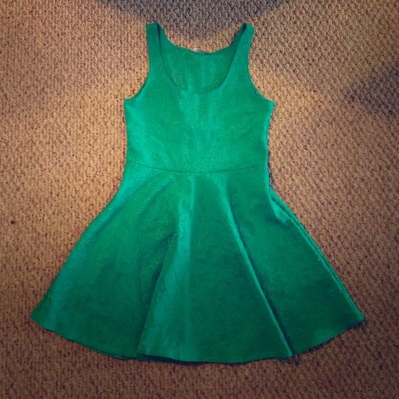 Green mini dress New,really cute,there's some stretch. Dresses Mini