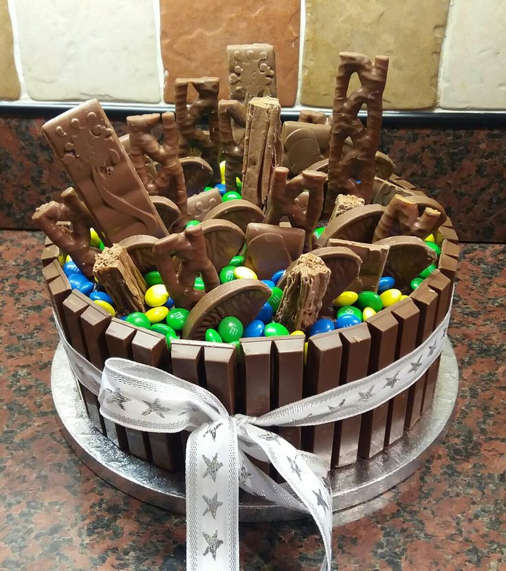 Dad's 65th Birthday Cake Hershey's Chocolatey Chocolate Cake with chocolate frosting 20 1/2 ×2 finger KitKats, 5 × thin Cadbury Dairy Milk, 3× Cadbury Flakes, 4× Curly Wurly's, 1 chocolate orange and a bag of M&M's - yum!!