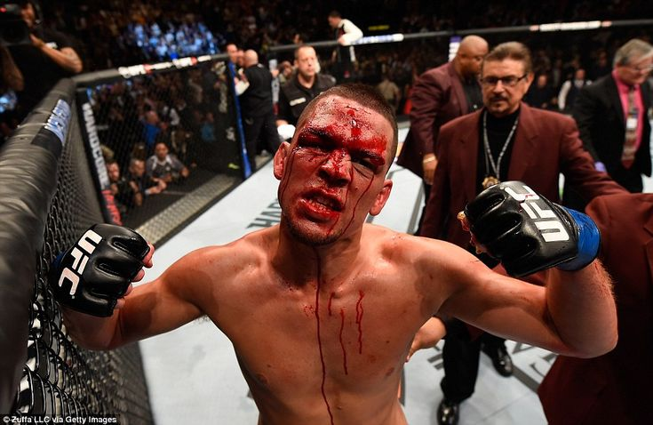 Nate Diaz celebrates after submitting Conor McGregor in the second round at UFC 196 on Sat...
