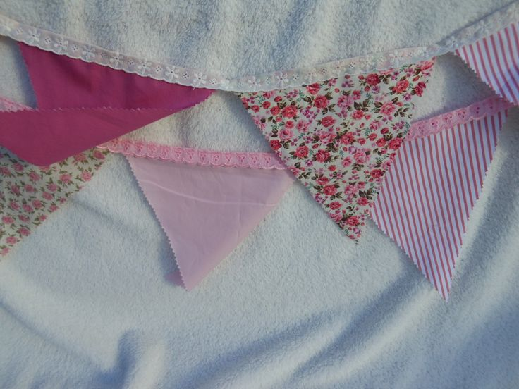 """Had an order for three strings of bunting done in pink paisley fabric with plains, stripes, dots and checks.  We trimmed them with anglaise lace to give them that """"vintage"""" look."""