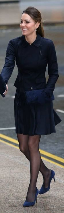 Who made  Kate Middleton's navy blue zipper coat, suede clutch handbag, and pleated skirt that she wore on November 20, 2013?