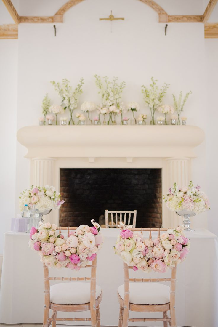 Wedding ceremony with pink peonie chair backs by fairynuff flowers at Northbrook Park in Surrey Photography by Marianne Taylor