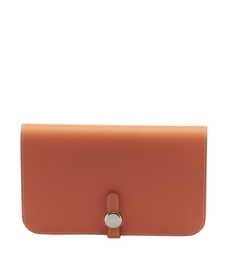 This Hermes Dogon Duo wallet features Prawn Pink Swift calfskin, silver-tone hardware, a classic Clou de Selle closure and a removable zippered change purse. It is new with defect, a loose stitch is p