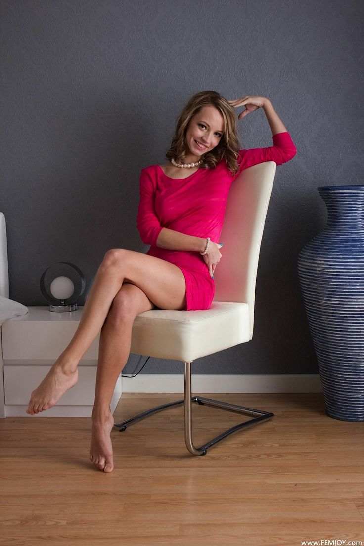 Beautiful Lady Looking Pretty In Pink Crossed Legs At