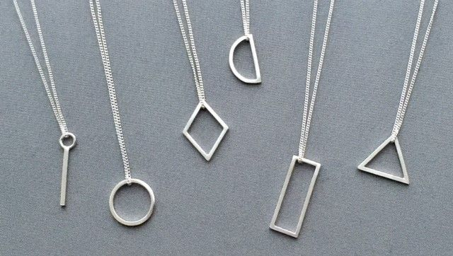 Small geometric shape necklaces in silver // Minimal luxe handmade jewellery by Elin Horgan