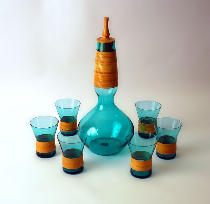 """Holmegaard Denmark  Kastrup. Blue wicker-wrapped glass decanter with wooden stopper with six wicker wrapped glasses, 1960s.  """"Kastrup Glas Made in Denmark"""""""