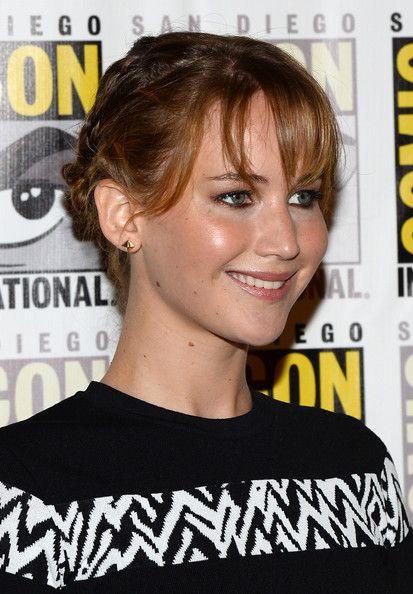 Jennifer Lawrence Braided Bun - Jennifer's adorable braided bun showed off her blushing cheeks and cheerful smile.