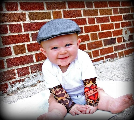 Tattoo Sleeve Onesie, omg. i hope one day i have babies to buy this for. so funny.