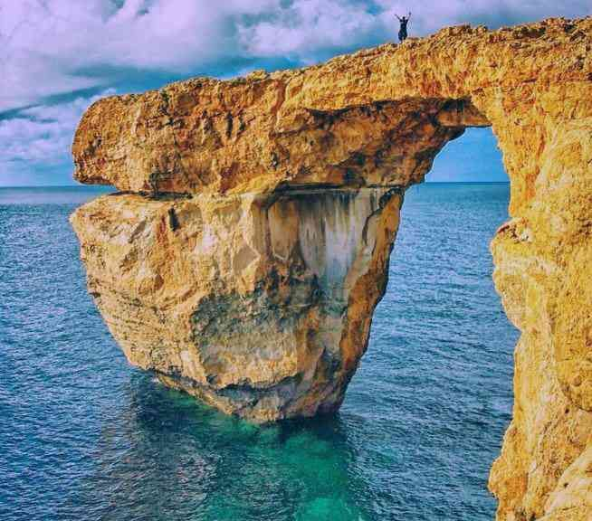The Azure Window in Malta - This natural arch was created after 2 sea caves collapsed.