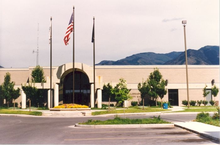 Logan Library - Historic Photo Collection:  Logan City Hall and Library. Date: August 1991. Address: 255 North Main Logan, Utah.  Extensive construction was completed on the Sears retail outlet building at 255 North Main, and both the City of Logan offices and Logan Library were opened for business in December 1985. The fourth library building in Logan shared the space with Logan City Hall. Logan City offices moved in 2009 giving the library full use of the building.
