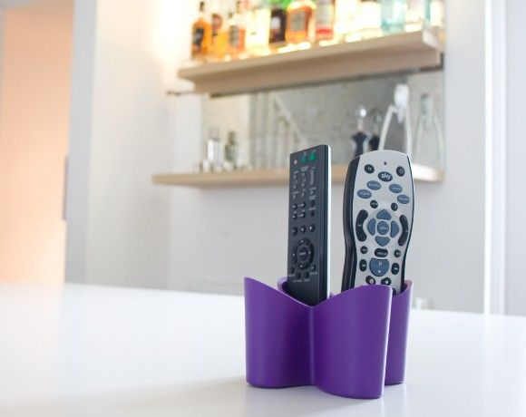 This remote control holder solves the age old problem of losing remotes & enables you to get your remotes under control, keeping them snug & tidy.