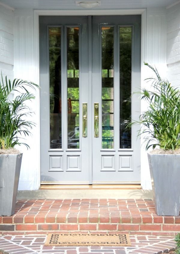Cool blue front door with fern planters
