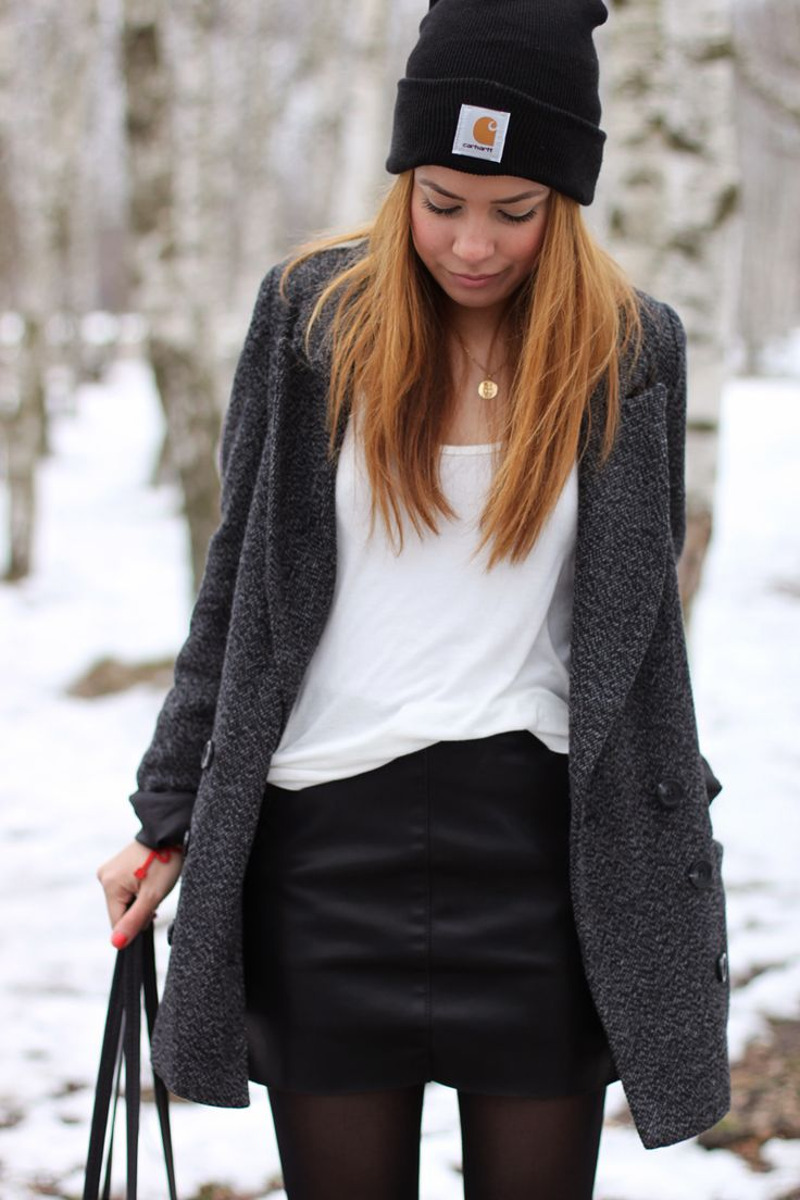 Desi is wearing black leather skirt from Zara, grey oversize coat and a Carhartt hat - teetharejade.com